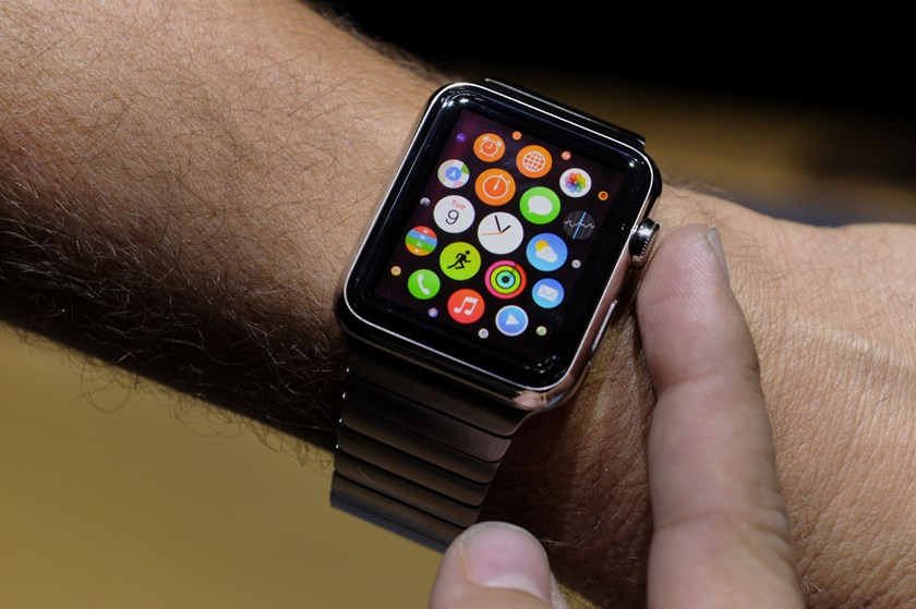 An attendee demonstrates the Apple Watch