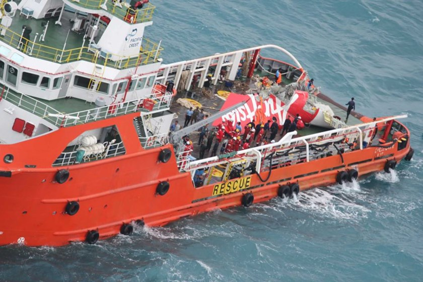 A supply ship carries the tail of Air Asia flight QZ8501, recovered from the sea