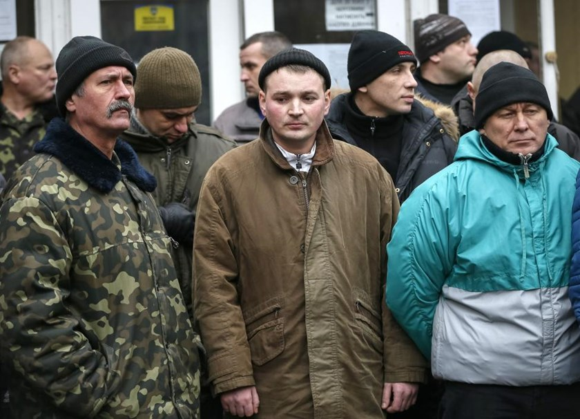 Conscripts attend a ceremony marking enrollment of new conscripts in the Ukrainian army in Kiev January 29, 2015.