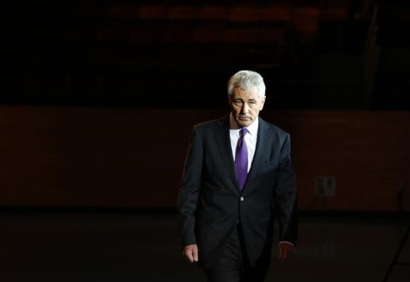 Outgoing U.S. Defense Secretary Chuck Hagel walks during a farewell ceremony at Joint Base Myer-Henderson Hall in Virginia, January 28, 2015.