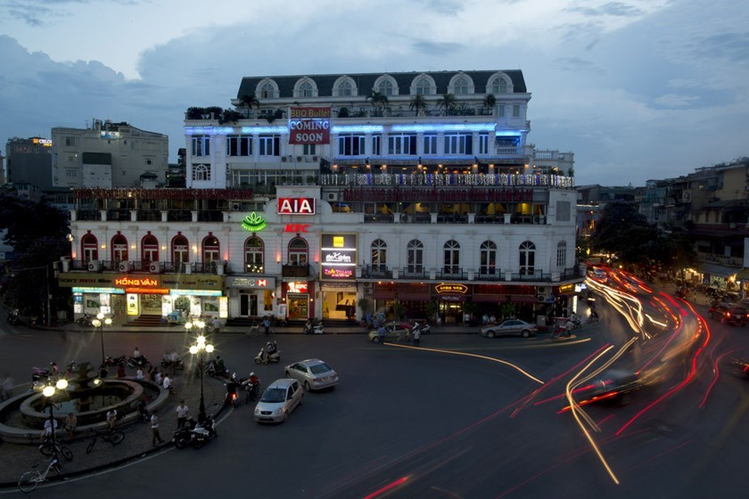 Traffic drives past commercial buildings in Hanoi, Vietnam. Photo: Bloomberg
