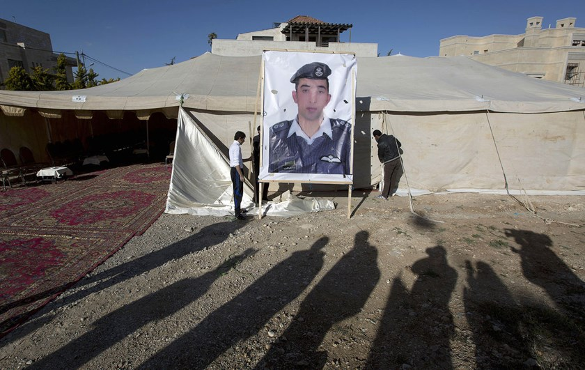 A banner with a picture of Jordanian pilot, Lt. Muath al-Kaseasbeh, who was held by Islamic State group militants, near a tent prepared for receiving supporters, in Amman, Jordan, on Jan. 30, 2015.