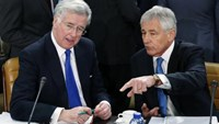 Britain's Defence Secretary Michael Fallon listens to U.S. Secretary of Defense Chuck Hagel (R) during a NATO defence ministers meeting at the Alliance headquarters in Brussels February 5, 2015.