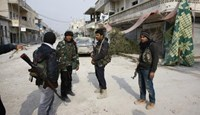 Fighters of the Kurdish People's Protection Units (YPG) patrol in the streets of the northern Syrian town of Kobani January 28, 2015.