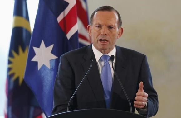 Australian Prime Minister Tony Abbott speaks at a joint news conference with his Malaysian counterpart Najib Razak during an official visit in Putrajaya September 6, 2014.