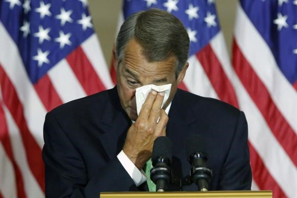 U.S. House Speaker John Boehner (R-OH) wipes away tears during his remarks at a Congressional Gold Medal ceremony at the U.S. Capitol in Washington February 3, 2015.
