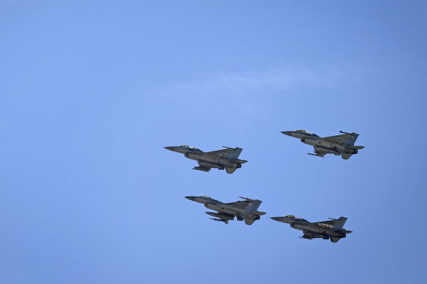 Jordanian Air Force fighter jets fly during the funeral of slain Jordanian pilot, Lt. Moath al-Kasassbeh, at his home village of Ai, near Karak, Jordan.