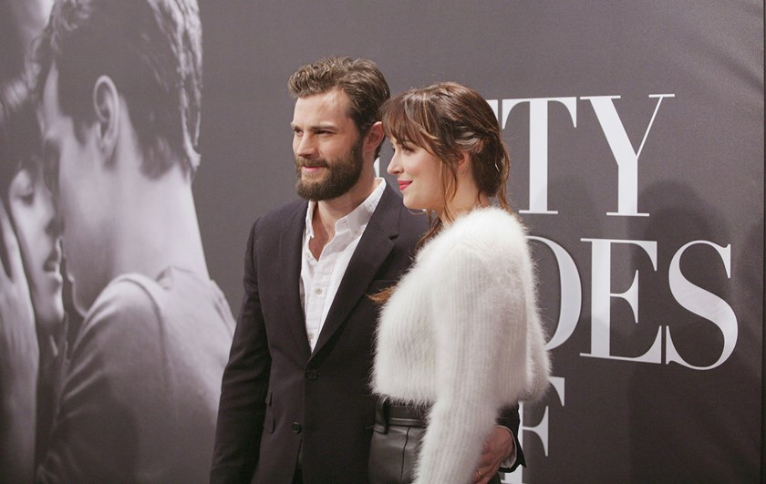 "Actors Jamie Dornan and Dakota Johnson attend the ""Fifty Shades Of Grey"" New York fan first screening at Ziegfeld Theatre on Feb. 6, 2015 in New York City."