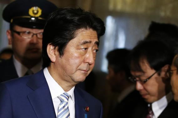 Japan's Prime Minister Shinzo Abe walks to the Lower House of the parliament in Tokyo February 5, 2015.