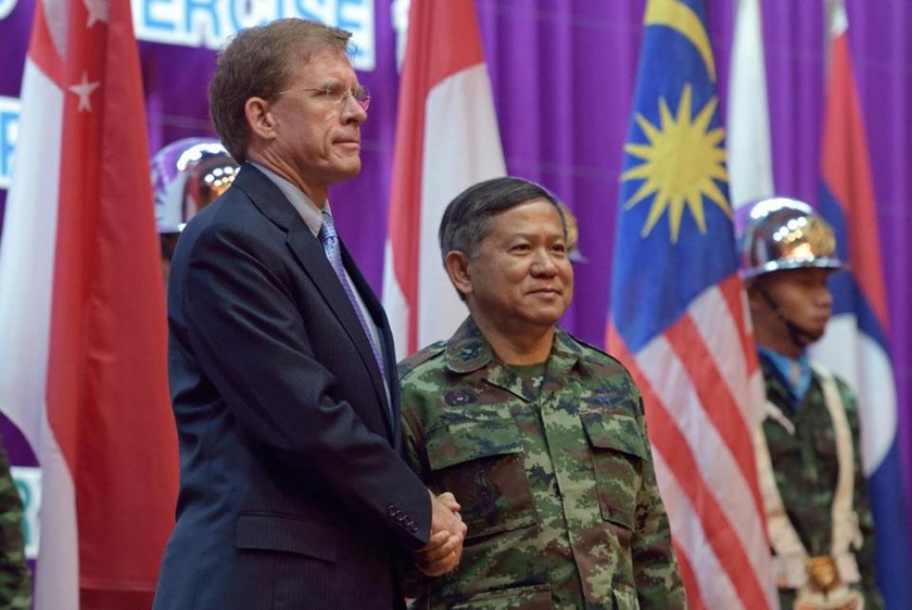 Thai Deputy Supreme Commander General Wuttinun Leelayudth (R) shakes hands with W. Patrick Murphy, Charge Affaires Embassy of the US in Thailand, during the opening ceremony for the annual joint military exercises, on February 9, 2015