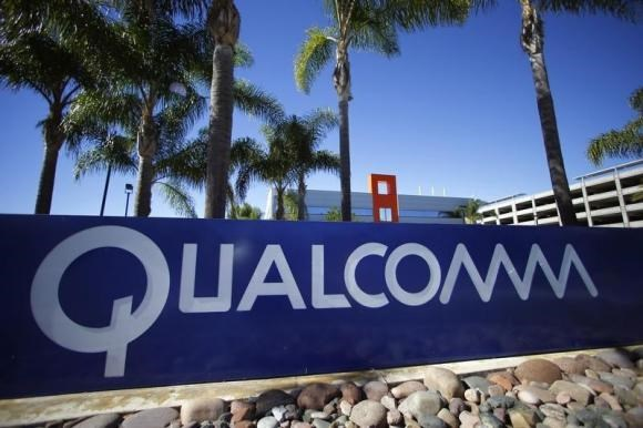 A Qualcomm sign is pictured in front of one of its many buildings in San Diego, California November 5, 2014.