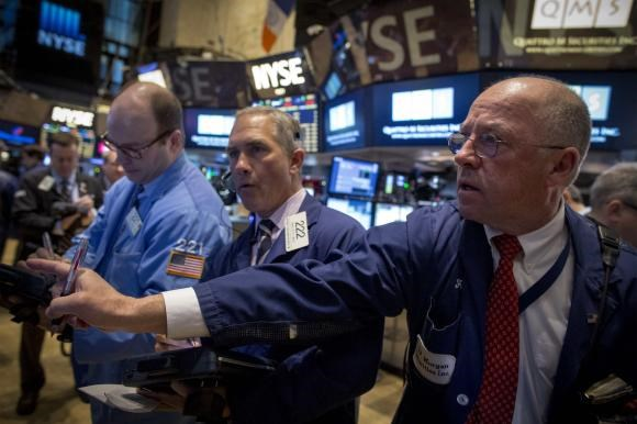 Traders work on the floor of the New York Stock Exchange February 9, 2015.