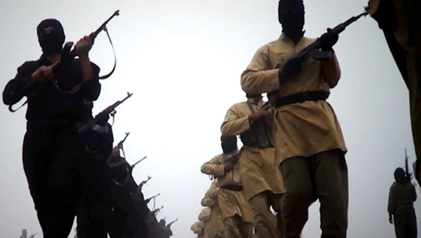 An image grab taken from a video released on January 4, 2014 by ISIL allegedly shows fighters marching at an undisclosed location