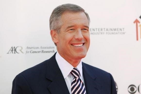 NBC news anchor Brian Williams poses at the ''Stand Up To Cancer'' television event, aimed at raising funds to accelerate innovative cancer research, at the Sony Studios Lot in Culver City, California September 10, 2010.