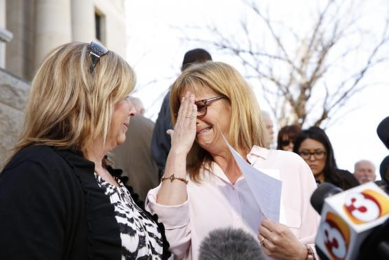 Terri Crippes (L) and Lori Lyon, the aunts of Kayla Mueller, react after giving a statement at a news conference in Prescott February 10, 2015.
