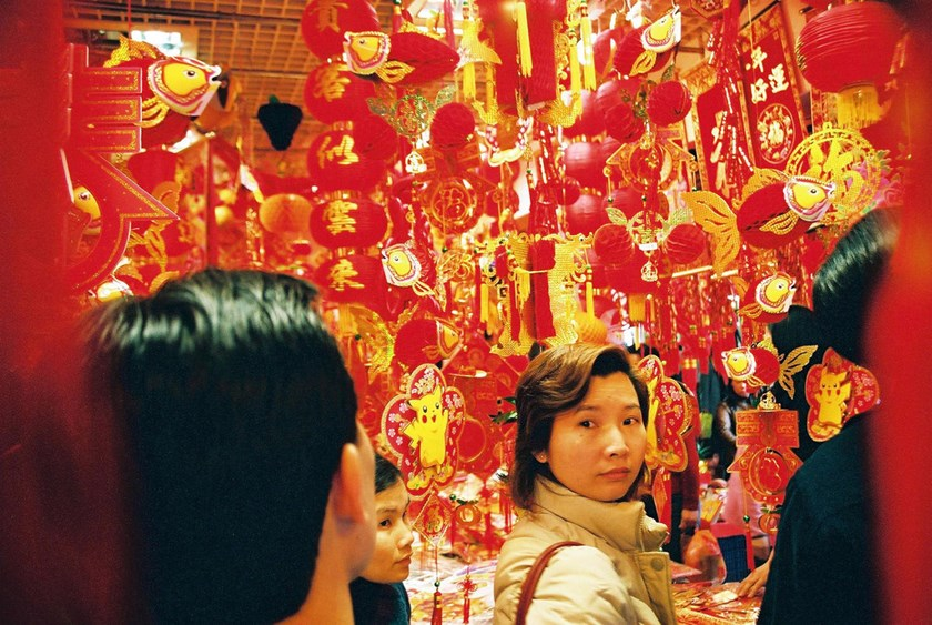 A shopper looks at traditional Chinese Lunar New Year ornaments in a market in Shenzhen, China.