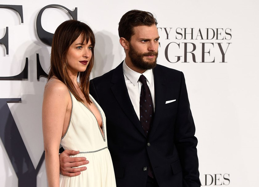 "Dakota Johnson and Jamie Dornan attend the U.K. Premiere of ""Fifty Shades Of Grey"" at Odeon Leicester Square in London on Feb. 12."