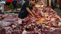 China entering New Year with fewer crackers, less pork, more thrift
