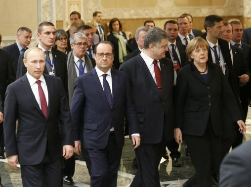 Russia's President Vladimir Putin (L, front), Ukraine's President Petro Poroshenko (2nd R, front), Germany's Chancellor Angela Merkel (R, front) and France's President Francois Hollande (2nd L, front) walk during peace talks in Minsk, February 11, 2015.