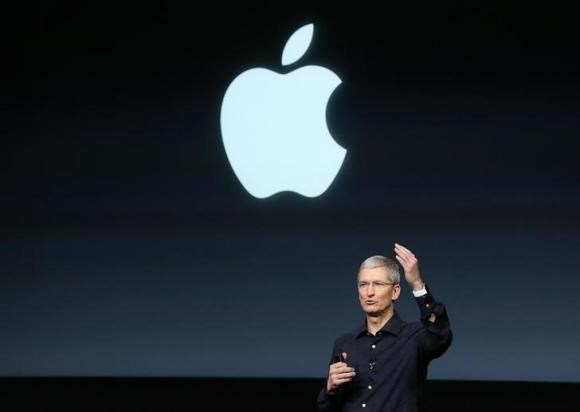 Apple CEO Tim Cook speaks during a presentation at Apple headquarters in Cupertino, California October 16, 2014.