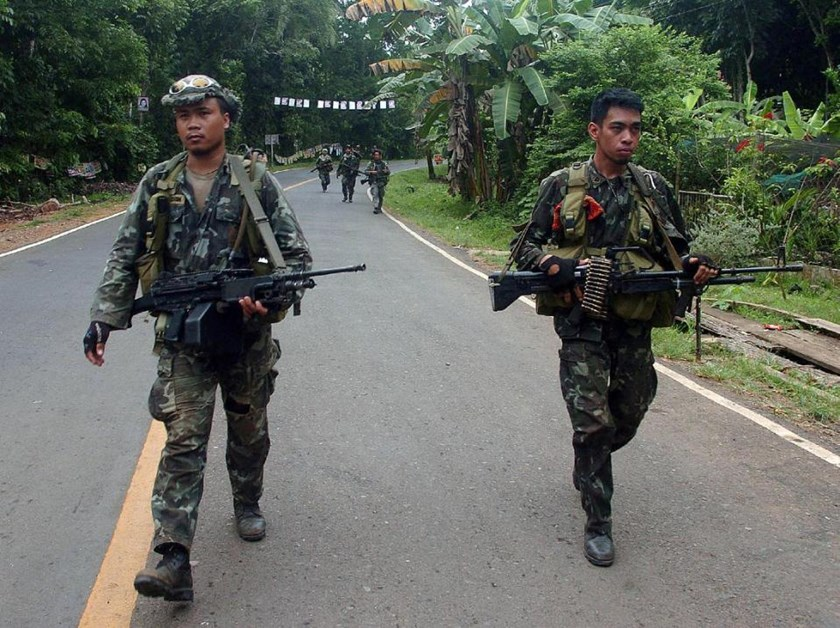 File photo of Philippine marines patrolling a highway on the southern Basilan island
