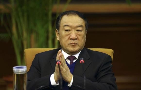 Su Rong attends a group discussion during the National People's Congress in Beijing March 6, 2012.