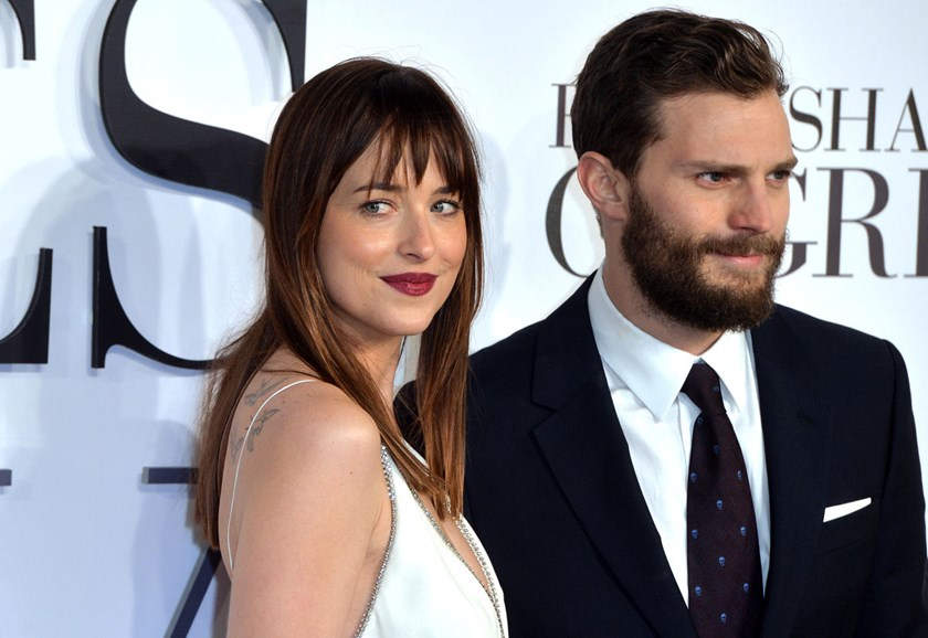 "Jamie Dornan, right, and Dakota Johnson attend the U.K. premiere of ""Fifty Shades of Grey"" at Odeon Leicester Square in London, on Feb. 12, 2015."