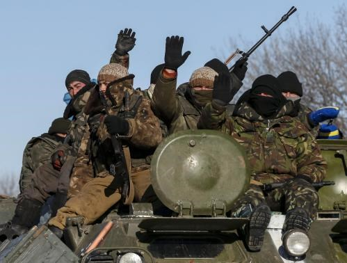Members of the Ukrainian armed forces ride on a military vehicle near Debaltseve, eastern Ukraine, February 17, 2015