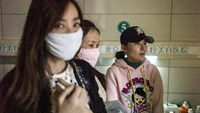 Women who say they have been left disfigured by shoddy procedures in South Korea, wait in a clinic in Beijing