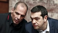 Greek Prime Minister Alexis Tsipras (R) and Finance Minister Yanis Varoufakis talk during the first round of a presidential vote at the Greek parliament in Athens, February 18, 2015.