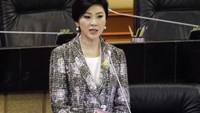 Ousted former Prime Minister Yingluck Shinawatra delivers her statement at the National Legislative Assembly meeting in Bangkok January 22, 2015.