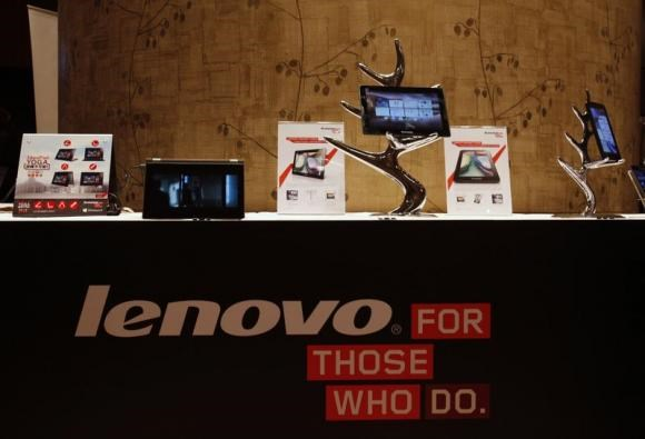 Lenovo tablets and mobile phones are displayed during a news conference on the company's annual results in Hong Kong in this May 23, 2013 file photo.