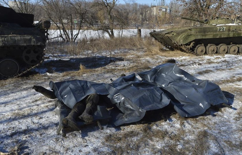 Bodies of Ukrainian soldiers killed in Debaltseve are pictured on stretchers at a military camp in Artemivsk, February 18, 2015.