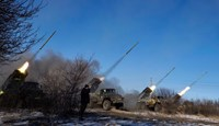 Pro-Russian rebels fire artillery rockets towards Debaltseve, near Vuglegirsk, Ukraine, on Feb. 18, 2015.