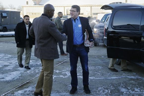 U.S. Secretary of Defense Ash Carter (C) is greeted by Senior Military Assistant U.S. Army Major General Ron Lewis (L) as they arrive to travel to Afghanistan from Joint Base Andrews, Maryland February 20, 2015.
