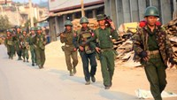 Myanmar soldiers patrol this week in Laukkai, the main city in the Kokang region, where fighting is raging
