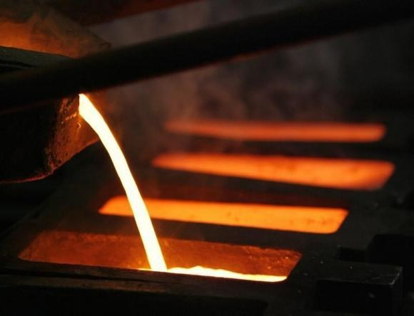 Gold is poured into a mould during processing at the PT Antam Tbk. precious metal refinery in Jakarta January 15, 2009.