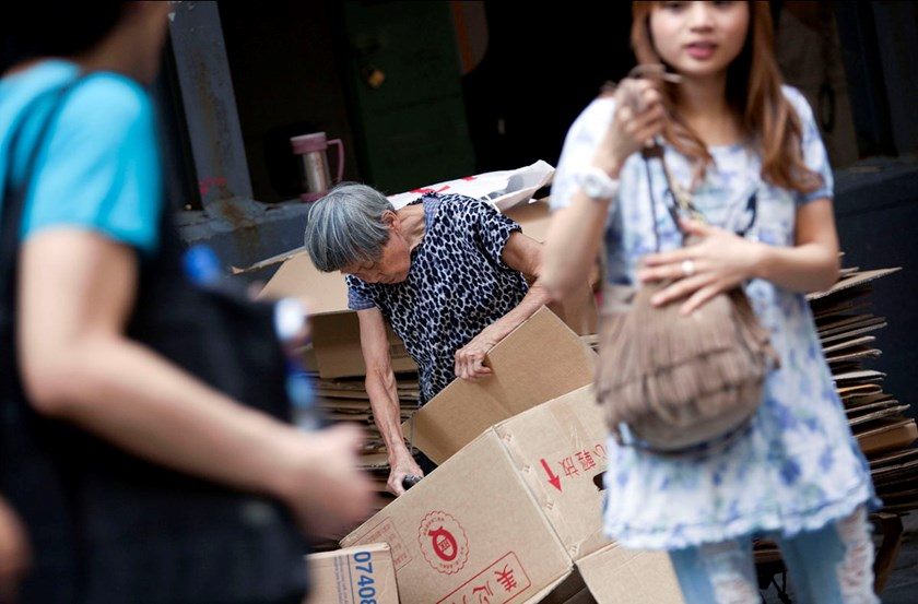 An elderly woman collects cardboard boxes in Hong Kong.