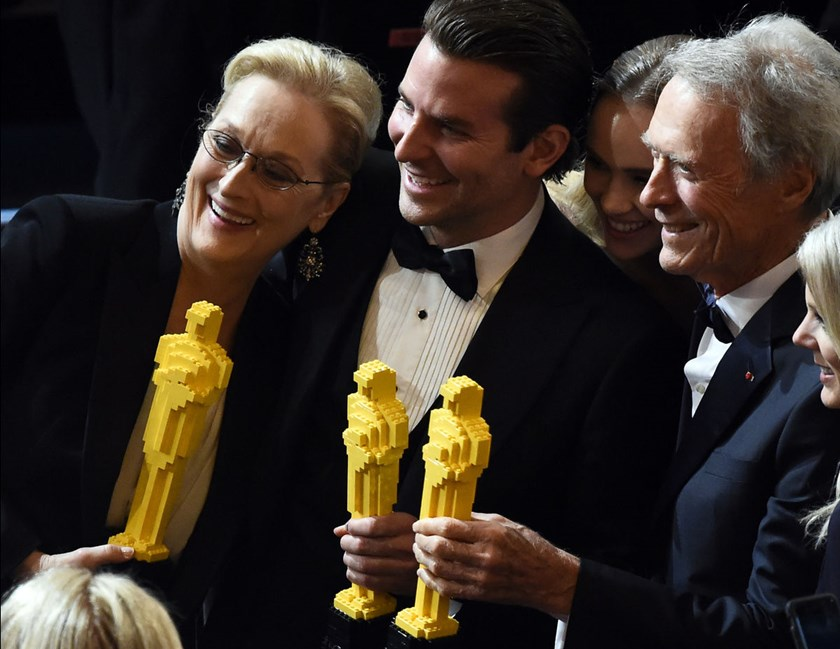Clint Eastwood, right, Meryl Streep, left, and Bradley Cooper pose for a photo with Oscars made of lego bricks after the end of the 87th Oscars February 22, 2015 in Hollywood, California.