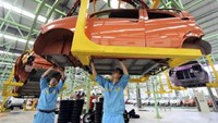 Employees assemble an electric car to be exported to South America along an production line at an electric vehicle factory in Zouping county, Shandong province September 24, 2013.