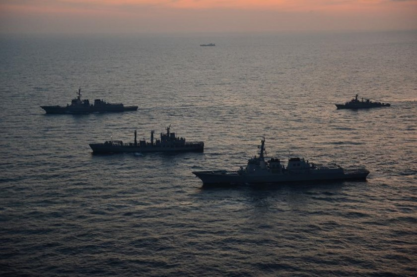 This handout photo released by South Korea Joint Chiefs of Staff on February 4, 2013 shows South Korean and US warships during a joint naval exercise in the East Sea