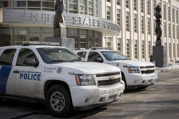 Federal Protective Service vehicles, which is a branch of Homeland Security, park outside the U.S. District Courthouse in the Brooklyn borough of New York February 25, 2015.