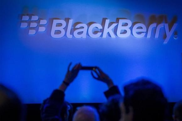 An attendee takes a photo during the launch event for the new Blackberry Classic smartphone in New York, December 17, 2014.