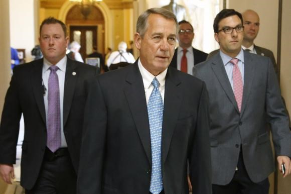 U.S. House Speaker John Boehner (R-OH) (C) returns to his office after a visit to the House floor for procedural votes for legislation to fund the Department of Homeland Security at the Capitol in Washington, February 27, 2015.