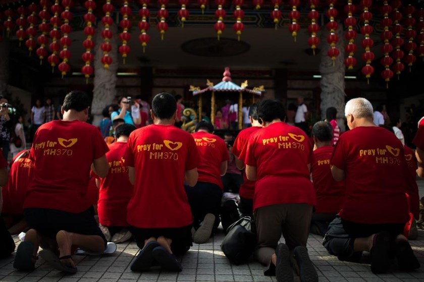 Relatives of passengers from the missing Malaysia Airlines flight MH370 offer prayers at Thean Hou Temple in Kuala Lumpur, on March 1, 2015