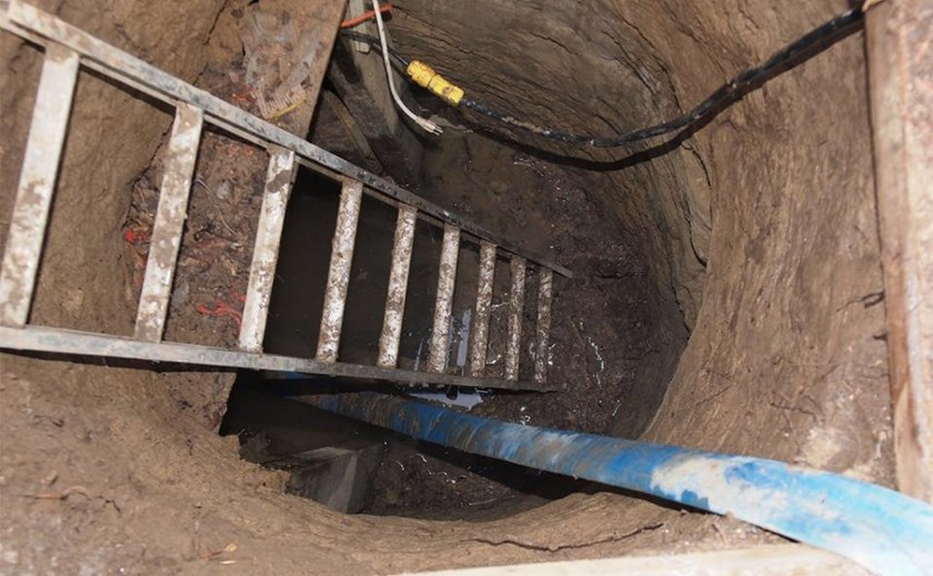 Image released on February 24, 2015 by the Toronto Police shows a ladder going down into a tunnel found near York University and the Rexall Center in the city