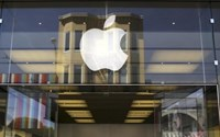 The Apple logo is pictured on the front of a retail store in the Marina neighborhood in San Francisco, California April 23, 2014.