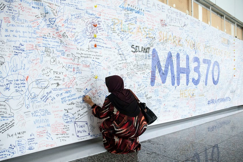 Factbox: One year on, MH370 theories abound