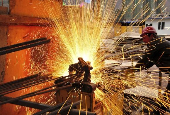 A worker welds at a construction site in Yiliang, Yunnan province, February 28, 2015.