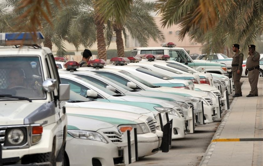 Saudi police cars are parked in central Riyadh on March 11, 2011